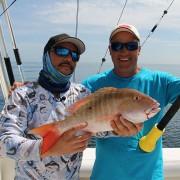 cushit cush-it fishing florida - mick and primo using rod butt cushion