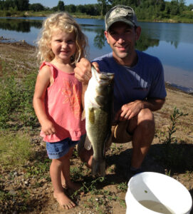 beginner fishing with spincast rod catches big bass